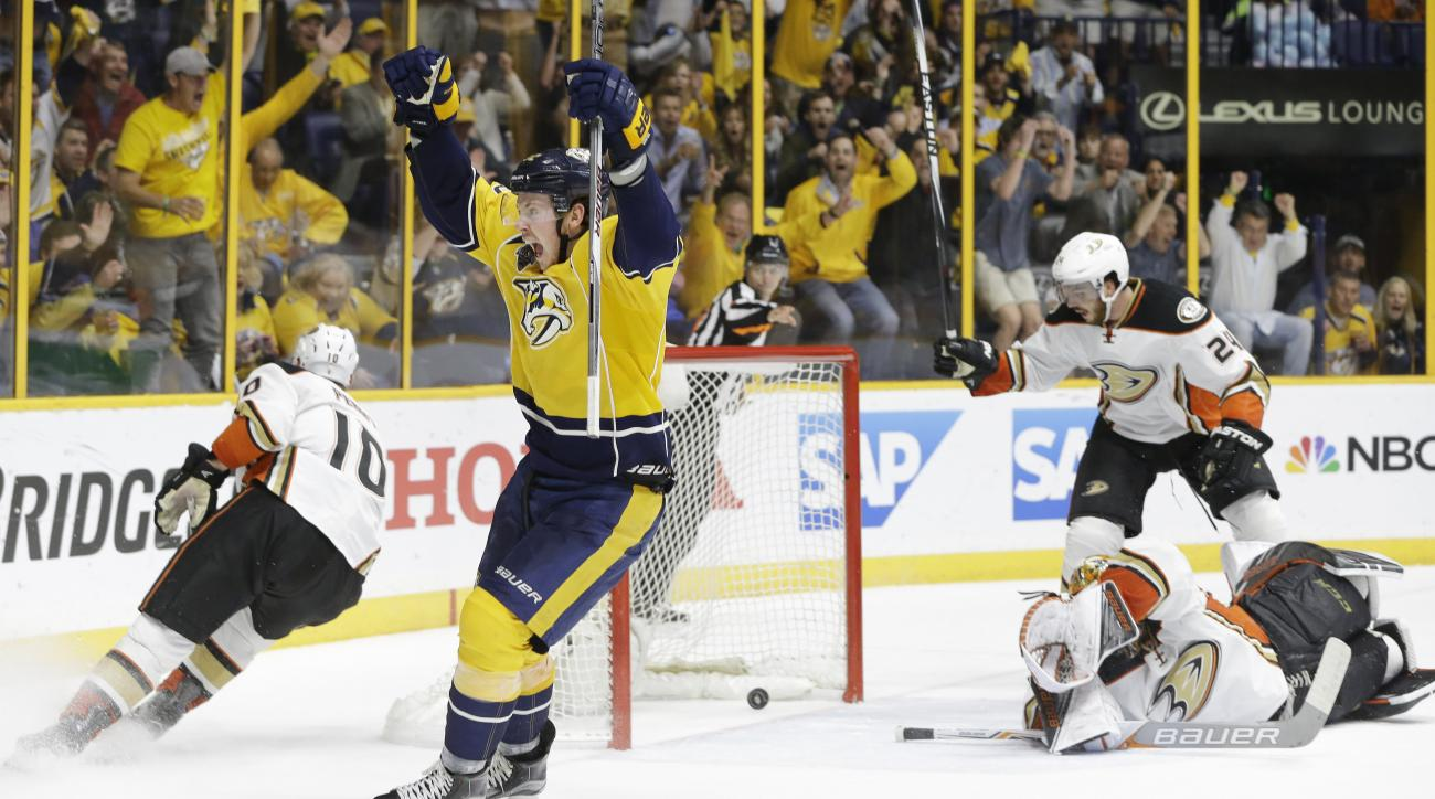 Nashville Predators center Ryan Johansen, second from left, celebrates a goal by teammate James Neal, not shown, against Anaheim Ducks goalie Frederik Andersen, of Denmark, lower right, in the second period of Game 6 in an NHL hockey first-round Stanley C