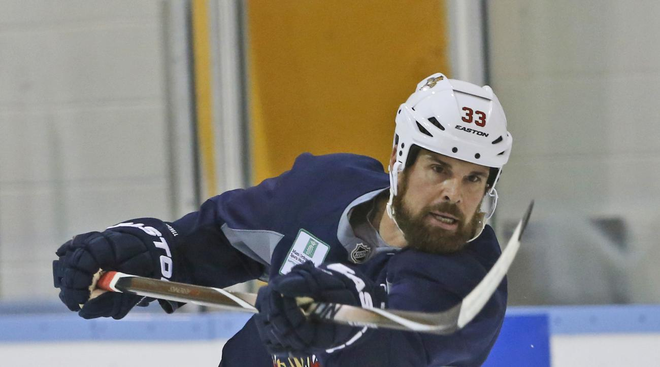 FILE - In this April 12, 2016 file photo, Florida Panthers defenseman Willie Mitchell takes a shot during a practice session, in Coral Springs, Fla. The Florida Panthers do not expect captain and two-time Stanley Cup winner Willie Mitchell to return next