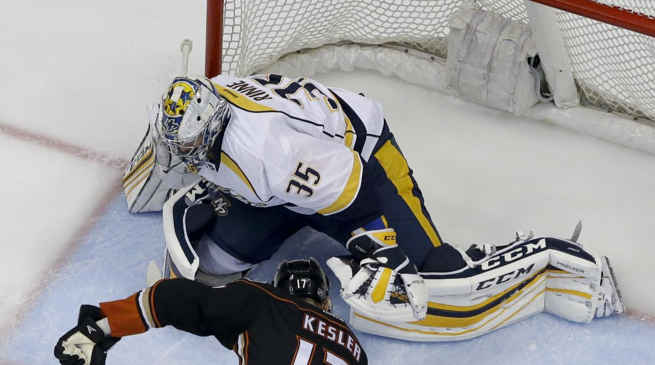 Nashville Predators goalie Pekka Rinne, top, blocks a shot by Anaheim Ducks center Ryan Kesler during the second period of Game 7 in an NHL hockey Stanley Cup playoffs first-round series in Anaheim, Calif., Wednesday, April 27, 2016. (AP Photo/Chris Carls