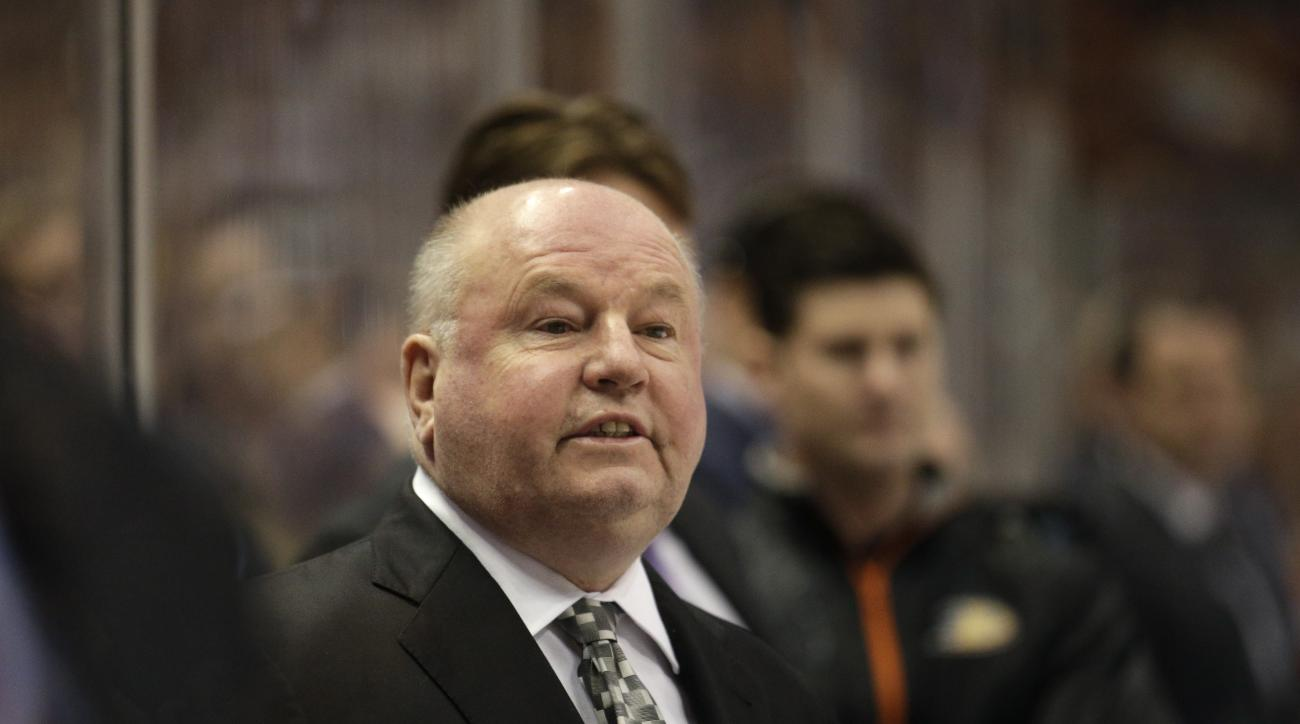 FILE - In this April 8, 2015 file photo,  Anaheim Ducks head coach Bruce Boudreau coaches his team during the first period of an NHL hockey game against the Dallas Stars, in Anaheim, Calif. The Anaheim Ducks have fired coach Bruce Boudreau after their fir