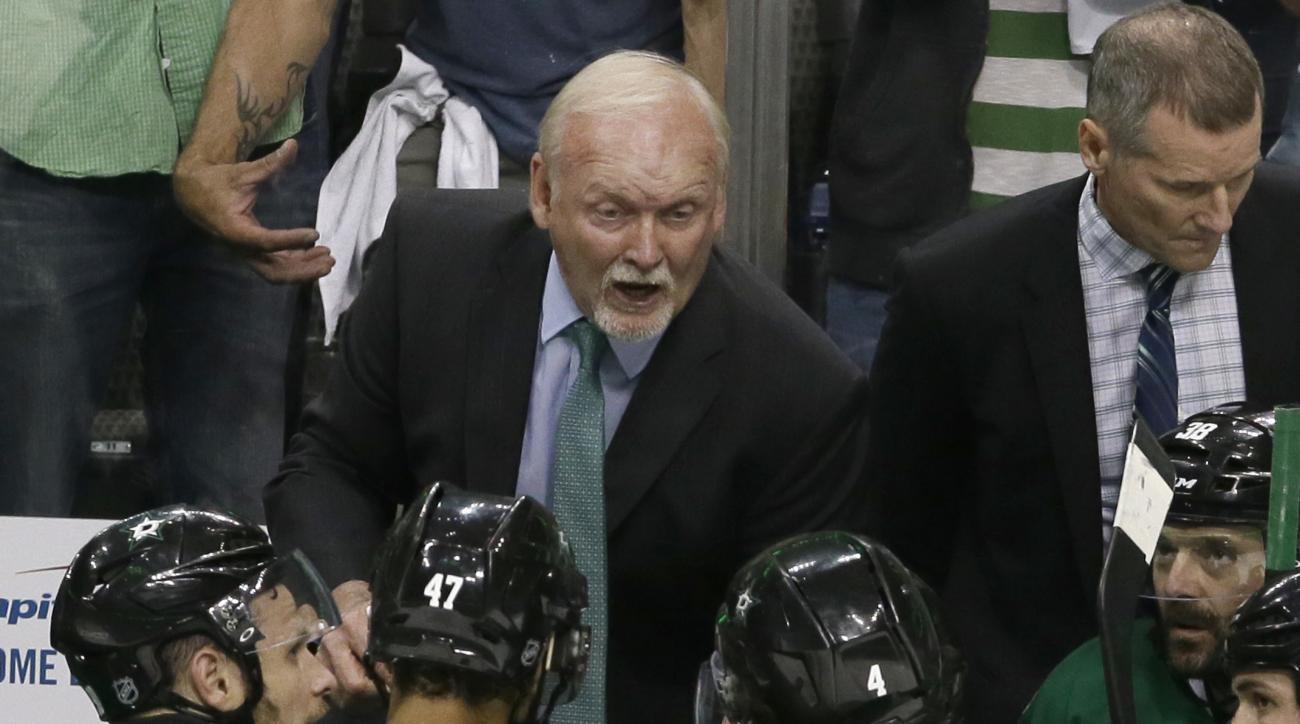 Dallas Stars head coach Lindy Ruff, top, talks to his players during the third period in Game 1 in the second round of the NHL Stanley Cup playoffs against the St. Louis Blues Friday, April 29, 2016, in Dallas.  (AP Photo/LM Otero)