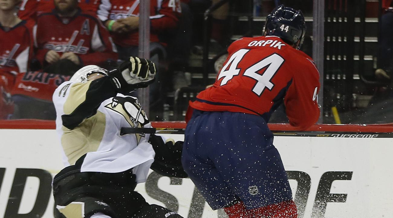 Washington Capitals defenseman Brooks Orpik (44) levels Pittsburgh Penguins defenseman Olli Maatta (3) with a high hit during the first period of Game 2 in an NHL hockey Stanley Cup Eastern Conference semifinal series Saturday, April 30, 2016 in Washingto