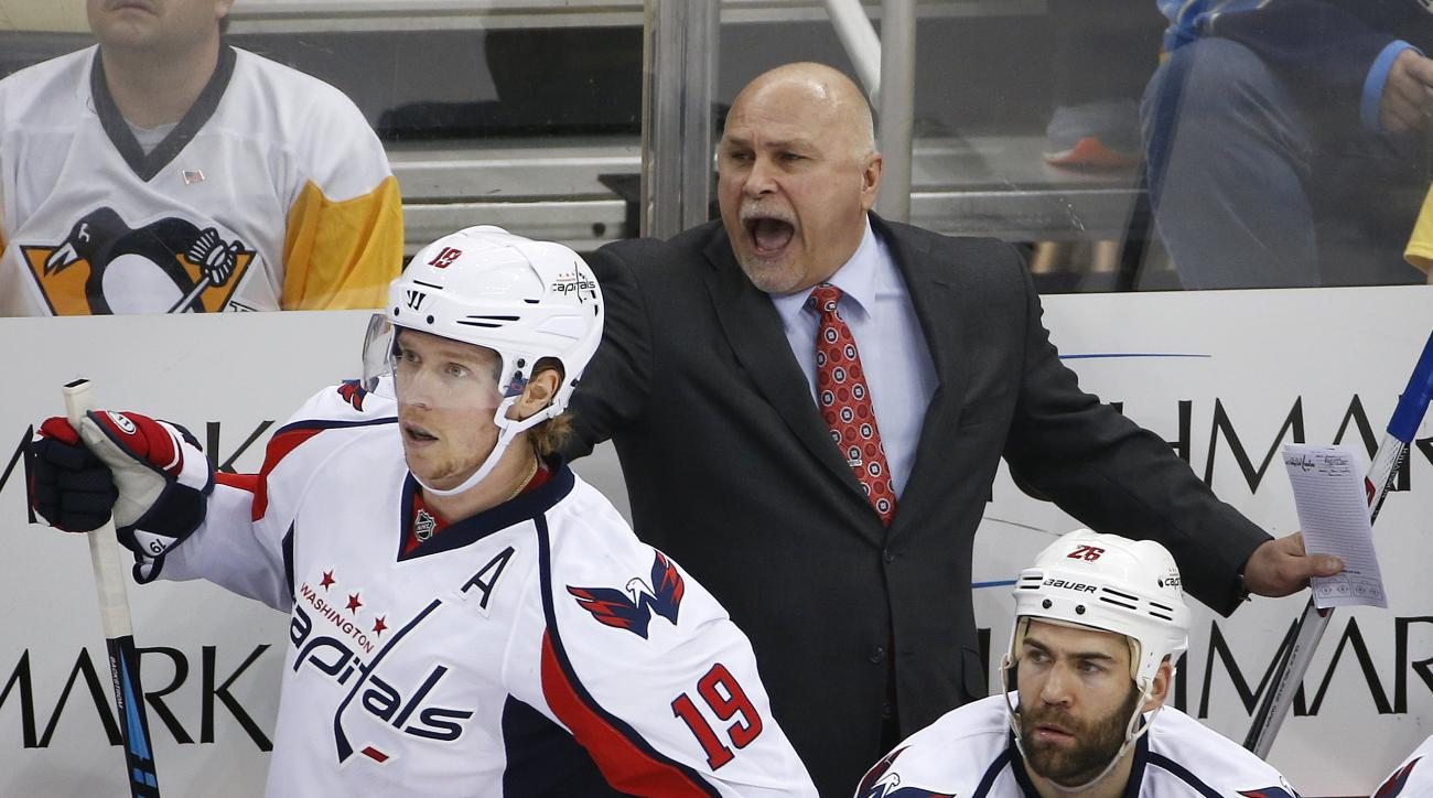 Washington Capitals head coach Barry Trotz yells at an official behind Nicklas Backstrom (19) during the first period of Game 3 in an NHL hockey Stanley Cup Eastern Conference semifinals in Pittsburgh, Monday, May 2, 2016. (AP Photo/Gene J. Puskar)