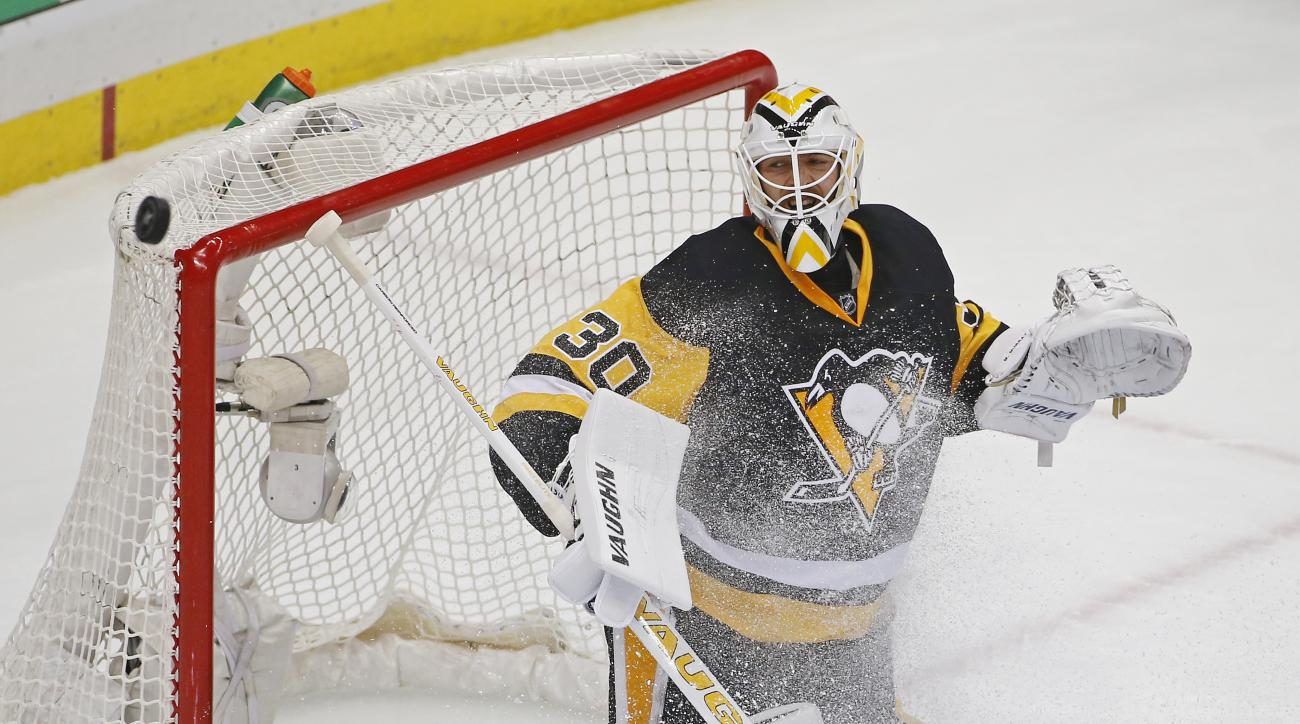 Pittsburgh Penguins goalie Matt Murray (30) deflects a puck over the net during the first period of Game 3 against the Washington Capitals in an NHL hockey Stanley Cup Eastern Conference semifinals in Pittsburgh, Monday, May 2, 2016. (AP Photo/Gene J. Pus