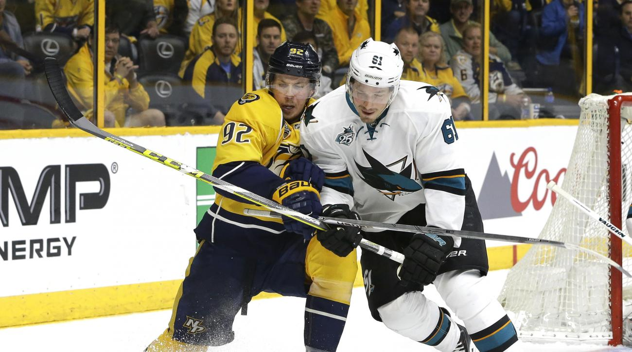 Nashville Predators center Ryan Johansen (92) and San Jose Sharks defenseman Justin Braun (61) battle for the puck during the second period in Game 3 of an NHL hockey Stanley Cup Western Conference semifinal playoff series Tuesday, May 3, 2016, in Nashvil