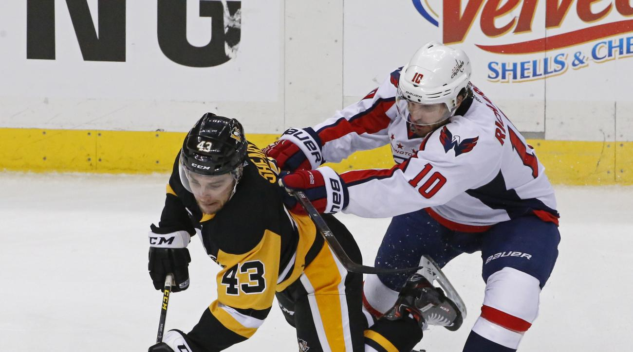 Pittsburgh Penguins Conor Sheary (43) is checked to the ice by Washington Capitals Mike Richards (10) during the third period of Game 4 in an NHL hockey Stanley Cup Eastern Conference semifinals in Pittsburgh, Wednesday, May 4, 2016. (AP Photo/Gene J. Pus