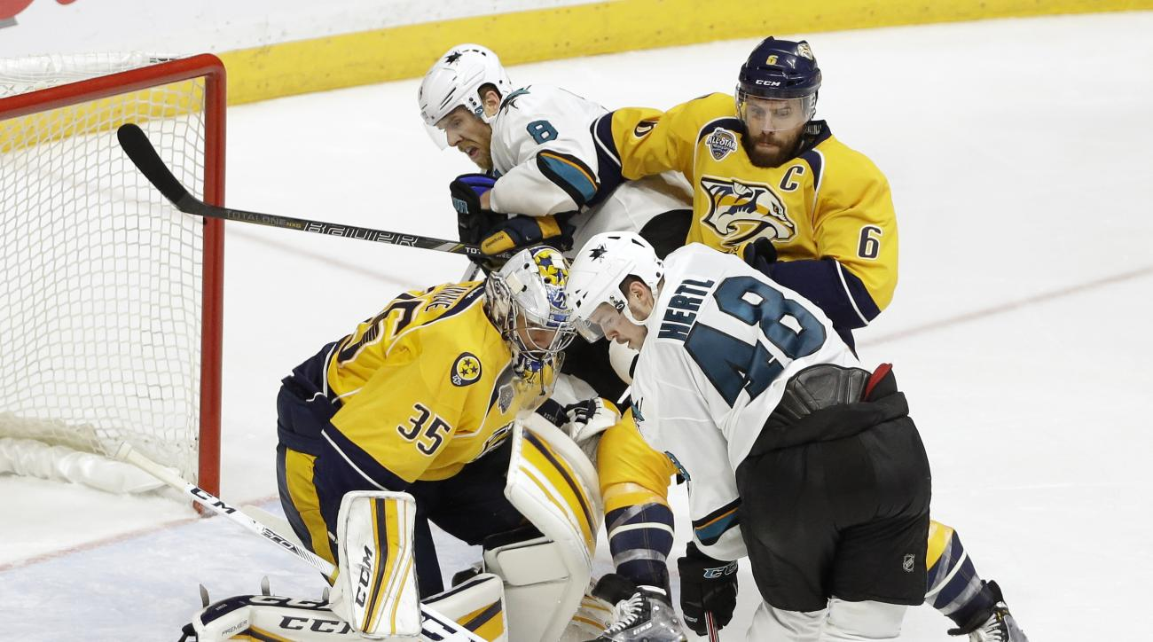 San Jose Sharks center Tomas Hertl (48), of the Czech Republic, tries to get control of the puck in front of Nashville Predators goalie Pekka Rinne (35), of Finland, during the second overtime period in Game 4 of an NHL hockey Stanley Cup Western Conferen