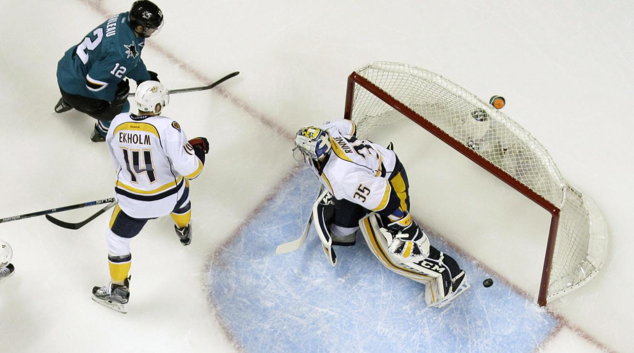 Nashville Predators goalie Pekka Rinne (35) is beaten for a goal on a shot from San Jose Sharks' Patrick Marleau, top left, during the first period of Game 5 in an NHL hockey Stanley Cup Western Conference semifinal series Saturday, May 7, 2016, in San Jo