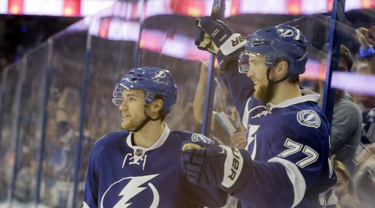 Tampa Bay Lightning's Victor Hedman (77), of Sweden, waves at his team after scoring a goal during the second period of Game 5 of the NHL hockey Stanley Cup Eastern Conference semifinals against the New York Islanders, Sunday, May 8, 2016, in Tampa, Fla.