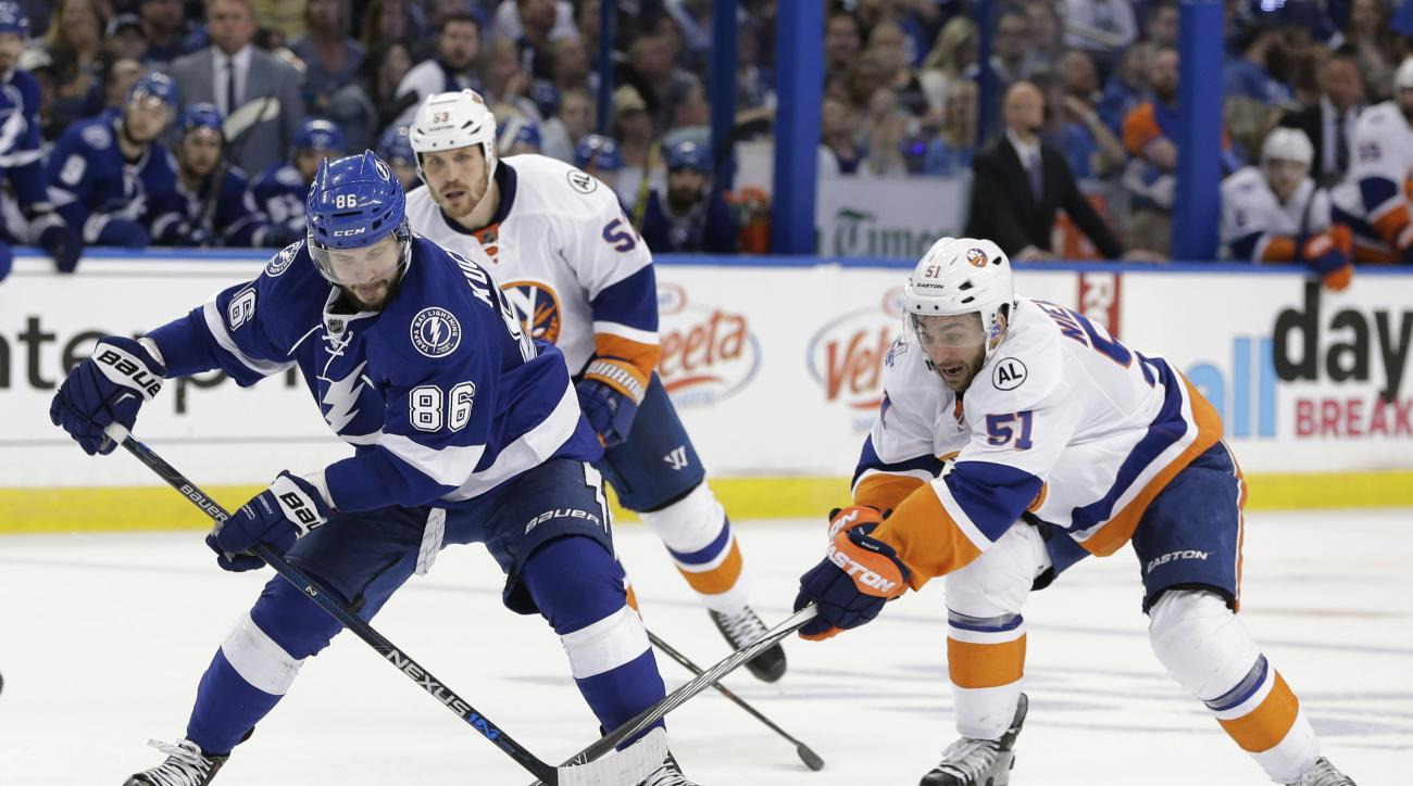 Tampa Bay Lightning's Nikita Kucherov (86), of Russia, and New York Islanders center Frans Nielsen (51), of Denmark, fight for control of the puck during the second period of Game 5 of the NHL hockey Stanley Cup Eastern Conference semifinals Sunday, May 8