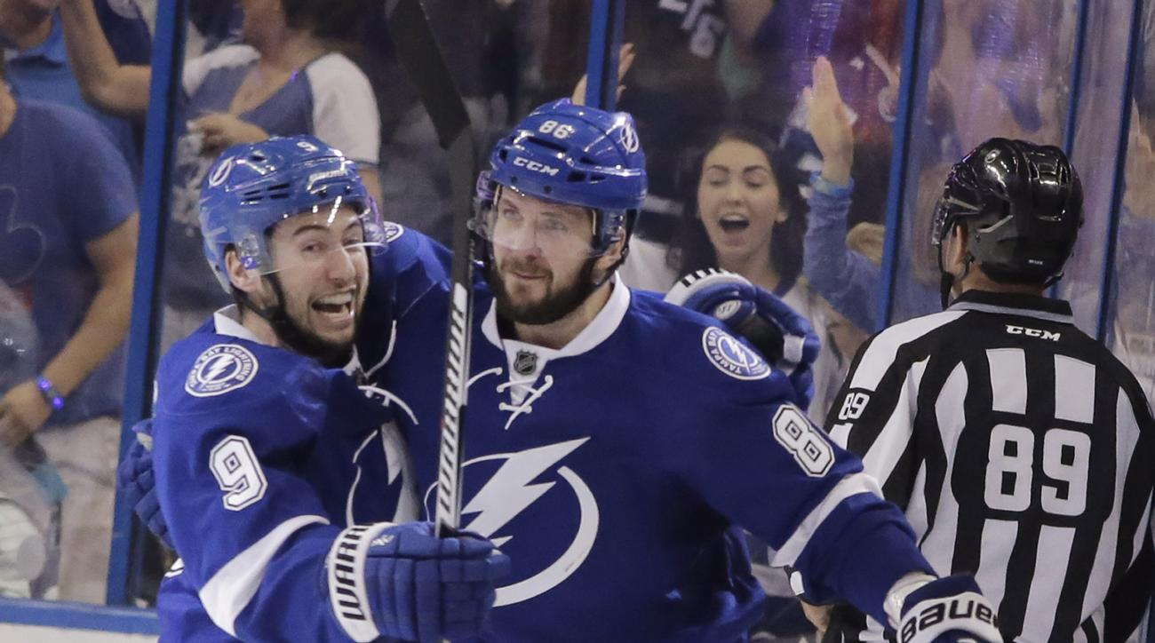 Tampa Bay Lightning's Tyler Johnson (9) congratulates teammate Nikita Kucherov (86), of Russia, after Kuchevov scored a goal during the third period of Game 5 of the NHL hockey Stanley Cup Eastern Conference semifinals against the New York Islanders, Sund