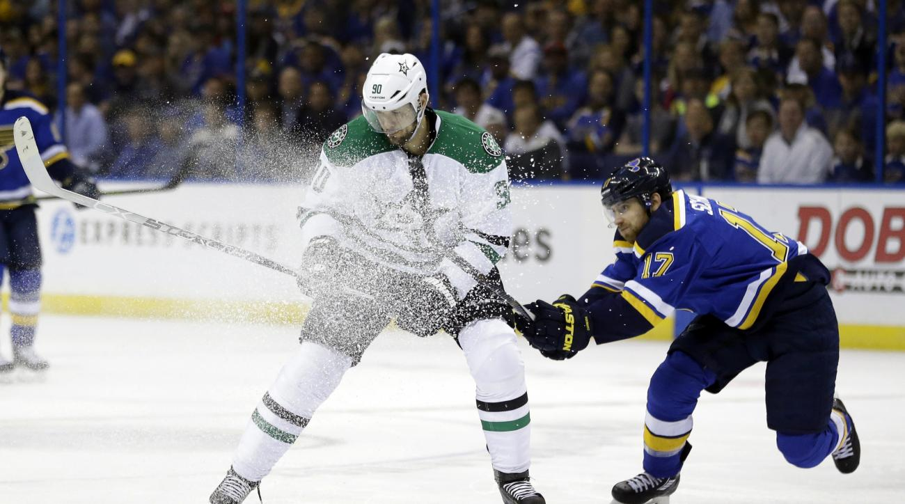 Dallas Stars' Jason Spezza, left, and St. Louis Blues' Jaden Schwartz chase after a loose puck during the first period of Game 6 of the NHL hockey Stanley Cup Western Conference semifinals, Monday, May 9, 2016, in St. Louis. (AP Photo/Jeff Roberson)