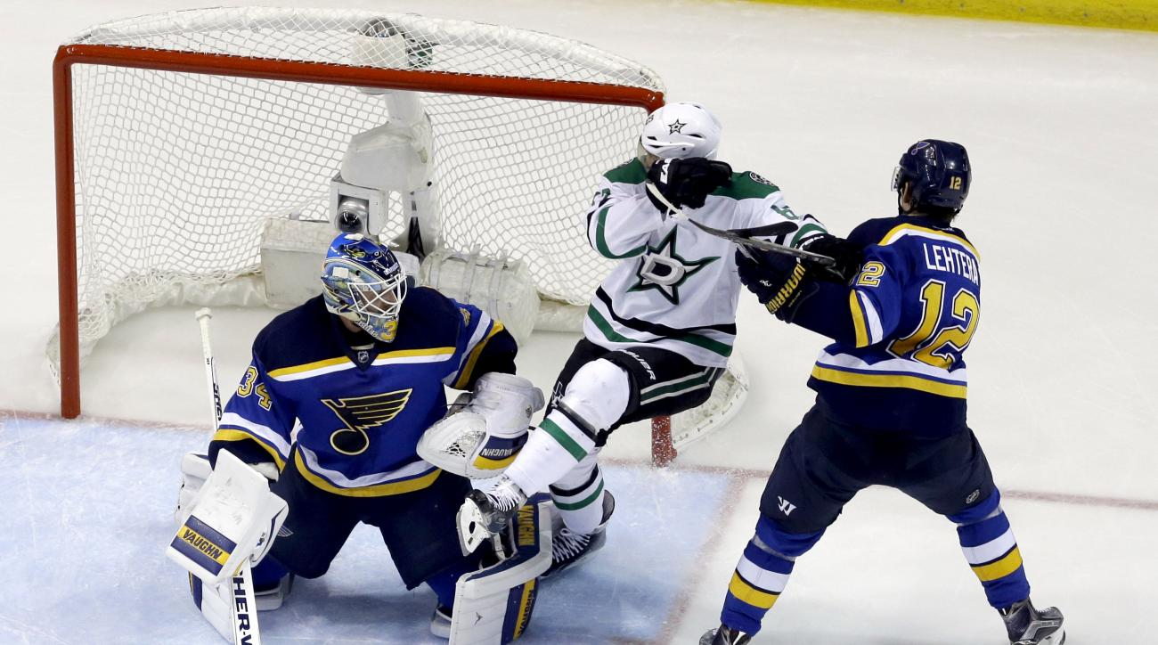 Dallas Stars' Ales Hemsky, of the Czech Republic, is caught between St. Louis Blues goalie Jake Allen, left, and Jori Lehtera, right, of Finland, during the second period of Game 6 of the NHL hockey Stanley Cup Western Conference semifinals, Monday, May 9