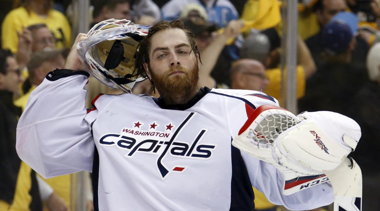 Washington Capitals goalie Braden Holtby adjusts his mask after Pittsburgh Penguins' Phil Kessel scored during the second period of Game 6 of the NHL hockey Stanley Cup Eastern Conference semifinals, Tuesday, May 10, 2016 in Pittsburgh. (AP Photo/Gene J.