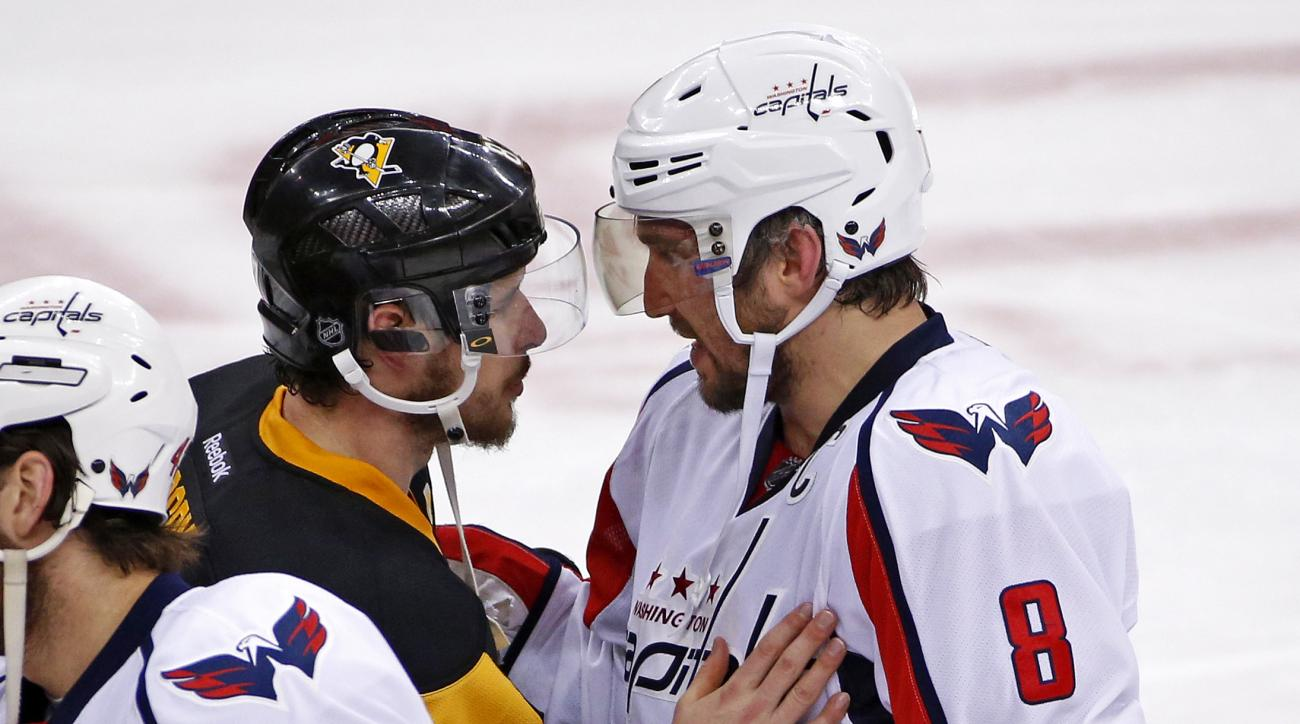 Pittsburgh Penguins' Sidney Crosby (87) and Washington Capitals' Alex Ovechkin (8) meet as the teams shake hands after a 4-3 overtime win by the Penguins in Game 6 of an NHL hockey Stanley Cup Eastern Conference semifinal series in Pittsburgh, Tuesday, Ma