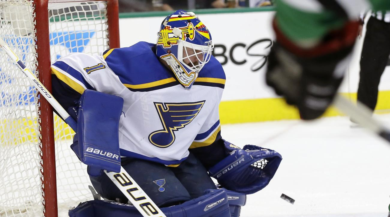 St. Louis Blues goalie Brian Elliott (1) blocks a shot during the first period of Game 7 of the NHL hockey Stanley Cup Western Conference semifinals against the Dallas Stars Wednesday, May 11, 2016, in Dallas. (AP Photo/LM Otero)