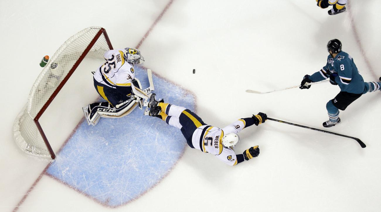 San Jose Sharks' Joe Pavelski (8) scores past Nashville Predators' Shea Weber (6) and goalie Pekka Rinne during the first period of Game 7 in an NHL hockey Stanley Cup Western Conference semifinal series Thursday, May 12, 2016, in San Jose, Calif. (AP Pho