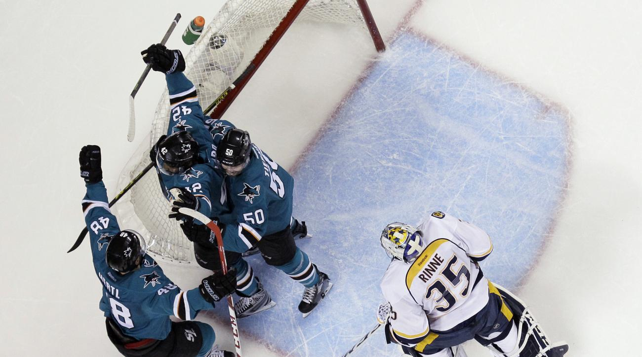 San Jose Sharks' Joel Ward (42) celebrates his goal with teammates Chris Tierney (50) and Tomas Hertl (48) next to Nashville Predators goalie Pekka Rinne (35) during the first period of Game 7 in an NHL hockey Stanley Cup Western Conference semifinal seri