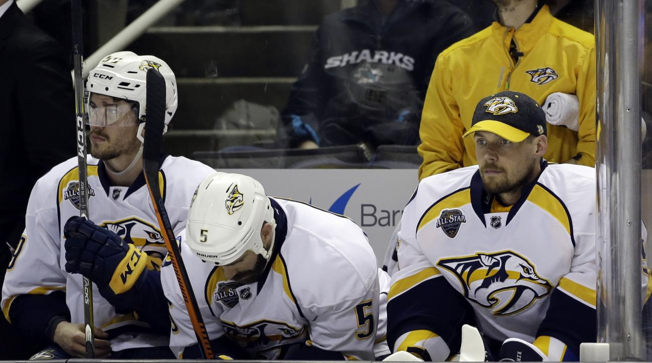 Nashville Predators goalie Pekka Rinne, right, sits on the bench after being pulled, next to teammates Barret Jackman (5) and Roman Josi (59) during the third period of Game 7 in an NHL hockey Stanley Cup Western Conference semifinal series against the Sa