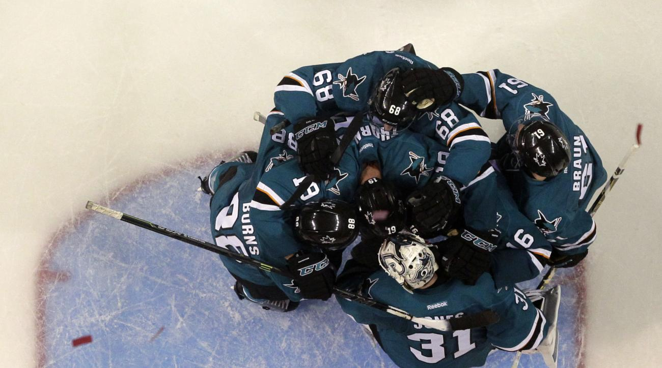 San Jose Sharks players celebrate a 5-0 win over the Nashville Predators during Game 7 in an NHL hockey Stanley Cup Western Conference semifinal series Thursday, May 12, 2016, in San Jose, Calif. The win sent the Sharks to the conference finals against th
