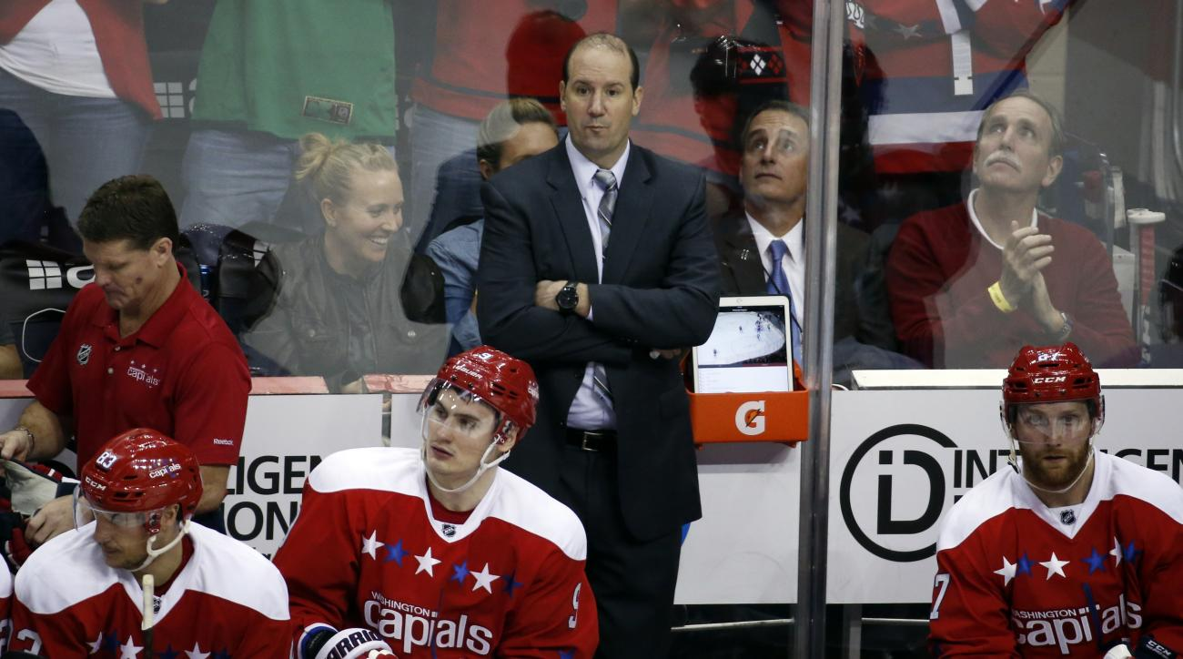 FILE - In this April 7, 2016 file photo, Washington Capitals assistant coach Todd Reirden stands in the bench area in the third period of an NHL hockey game against the Pittsburgh Penguins, in Washington. Reirdens road to coaching started as a journeyman