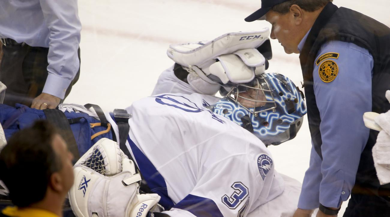 Tampa Bay Lightning goalie Ben Bishop is carted off the ice after being injured during the first period of Game 1 against the Pittsburgh Penguins in the NHL hockey Stanley Cup Eastern Conference finals Friday, May 13, 2016, in Pittsburgh. (AP Photo/Gene J