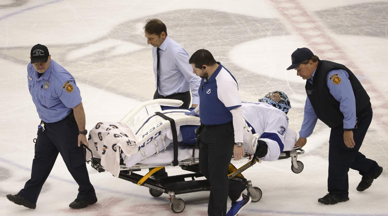 Tampa Bay Lightning goalie Ben Bishop (30) is carted off the ice after being injured during the first period of Game 1 against the Pittsburgh Penguins in the NHL hockey Stanley Cup Eastern Conference finals Friday, May 13, 2016, in Pittsburgh. (AP Photo/G