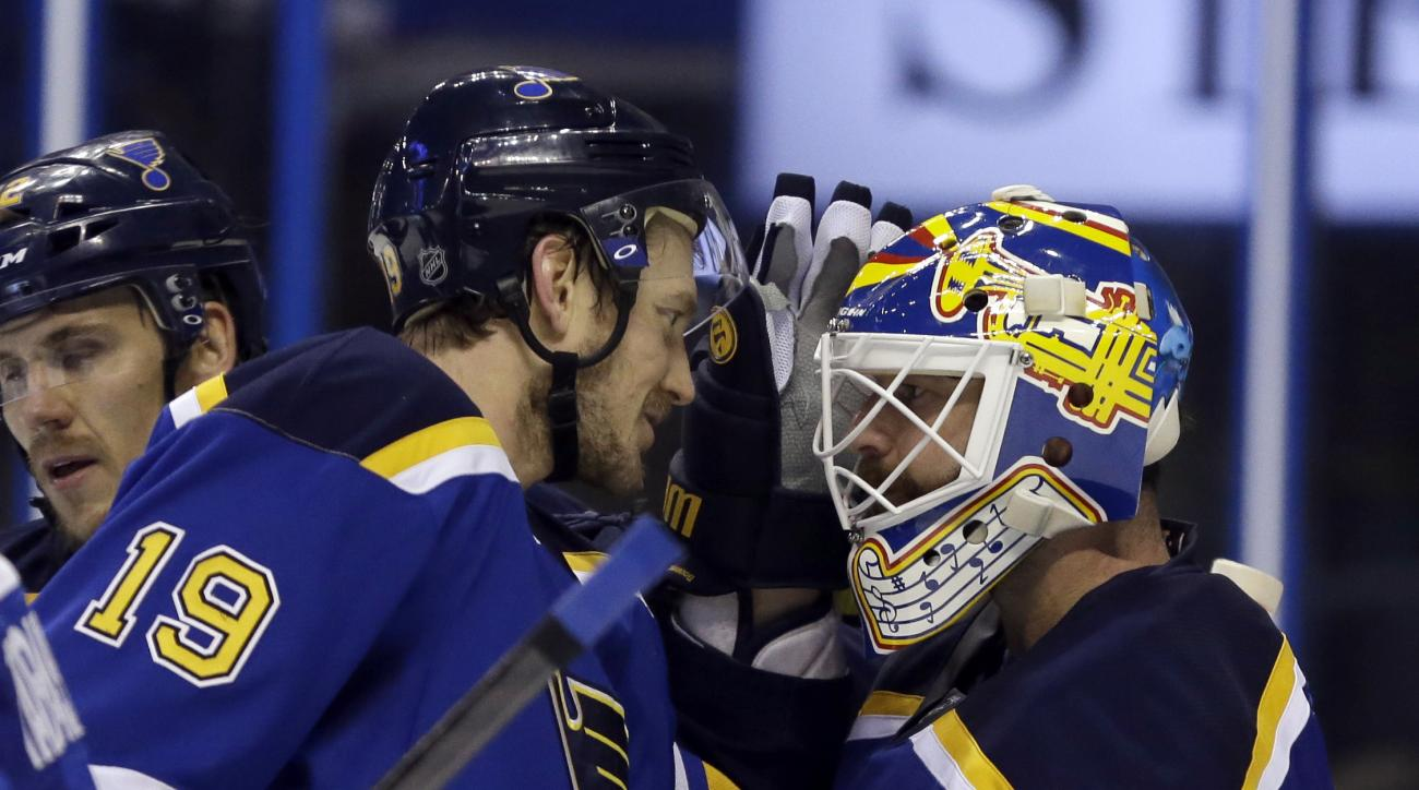 St. Louis Blues defenseman Jay Bouwmeester (19) and goalie Brian Elliott (1) celebrate after Game 1 of the NHL hockey Stanley Cup Western Conference finals against the San Jose Sharks, Sunday, May 15, 2016, in St. Louis. The Blues won 2-1. (AP Photo/Jeff