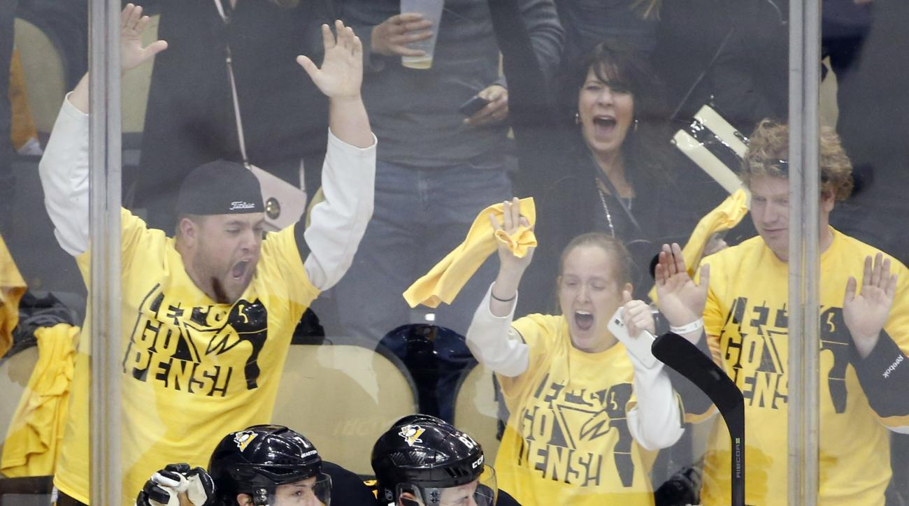 Pittsburgh Penguins' Sidney Crosby celebrates with teammate Matt Cullen and the fans after scoring the game winning goal in the overtime period of Game 2 of the NHL hockey Stanley Cup Eastern Conference finals, Monday, May 16, 2016, in Pittsburgh. The Pen