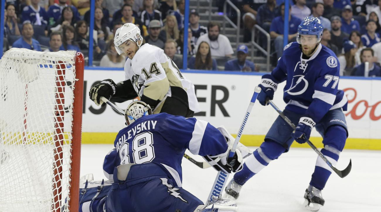 Pittsburgh Penguins left wing Chris Kunitz (14) scores a goal against Tampa Bay Lightning goalie Andrei Vasilevskiy (88), of Russia, during the third period of Game 3 of the NHL hockey Stanley Cup Eastern Conference Finals Wednesday, May 18, 2016, in Tamp