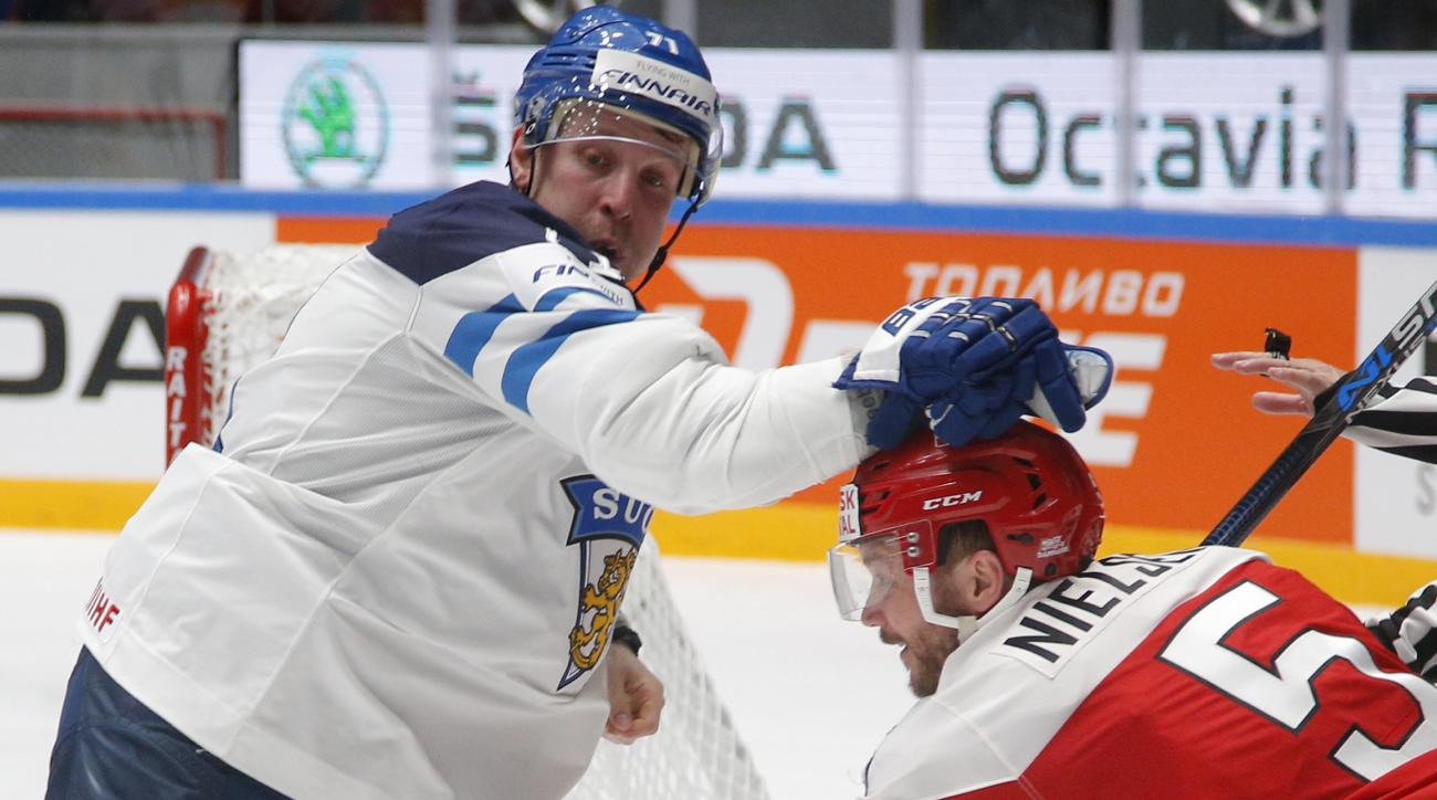 Leo Komarov of Finland, left, challenges Denmarks Daniel Nielsen during the Hockey World Championships quarterfinal match between Finland and Denmark in St.Petersburg, Russia, Thursday, May 19, 2016. (AP Photo/Dmitri Lovetsky)