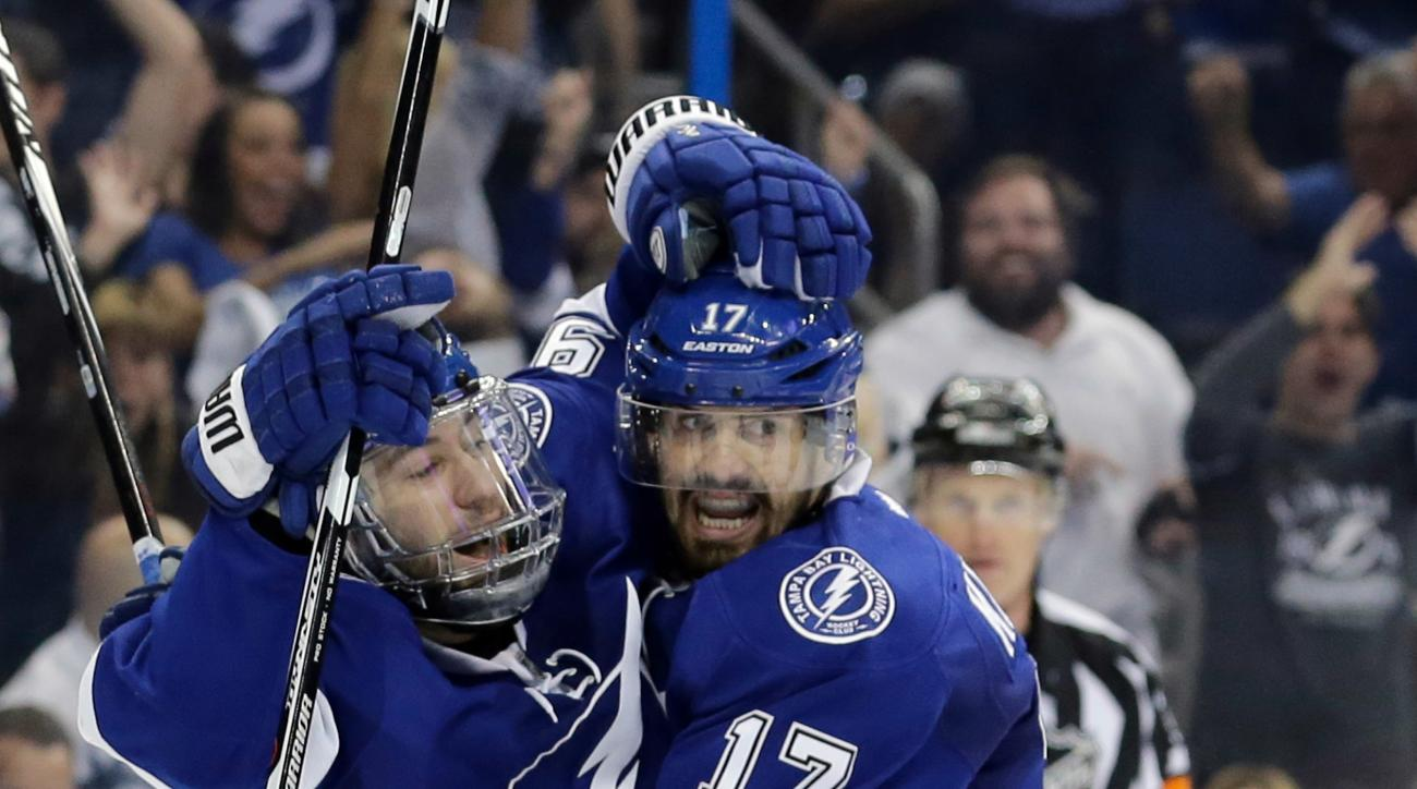 Tampa Bay Lightning's Tyler Johnson, left, celebrates his goal with teammate Alex Killorn (17), next to Pittsburgh Penguins goalie Matt Murray (30) during the second period of Game 4 of the NHL hockey Stanley Cup Eastern Conference finals Friday, May 20,
