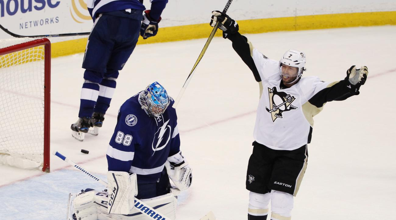 Pittsburgh Penguins center Matt Cullen (7) celebrates a goal by teammate Sidney Crosby (87), as Tampa Bay Lightning goalie Andrei Vasilevskiy (88), of Russia, remains kneeling on the ice, during the second period of Game 6 of the NHL hockey Stanley Cup Ea