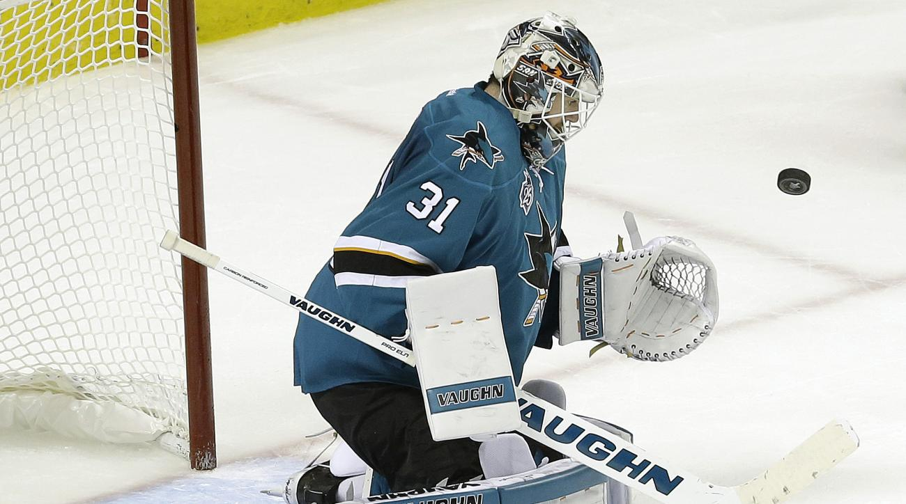 San Jose Sharks goalie Martin Jones (31) deflects a shot by the St. Louis Blues during the second period in Game 6 of the NHL hockey Stanley Cup Western Conference finals in San Jose, Calif., Wednesday, May 25, 2016. (AP Photo/Jeff Chiu)