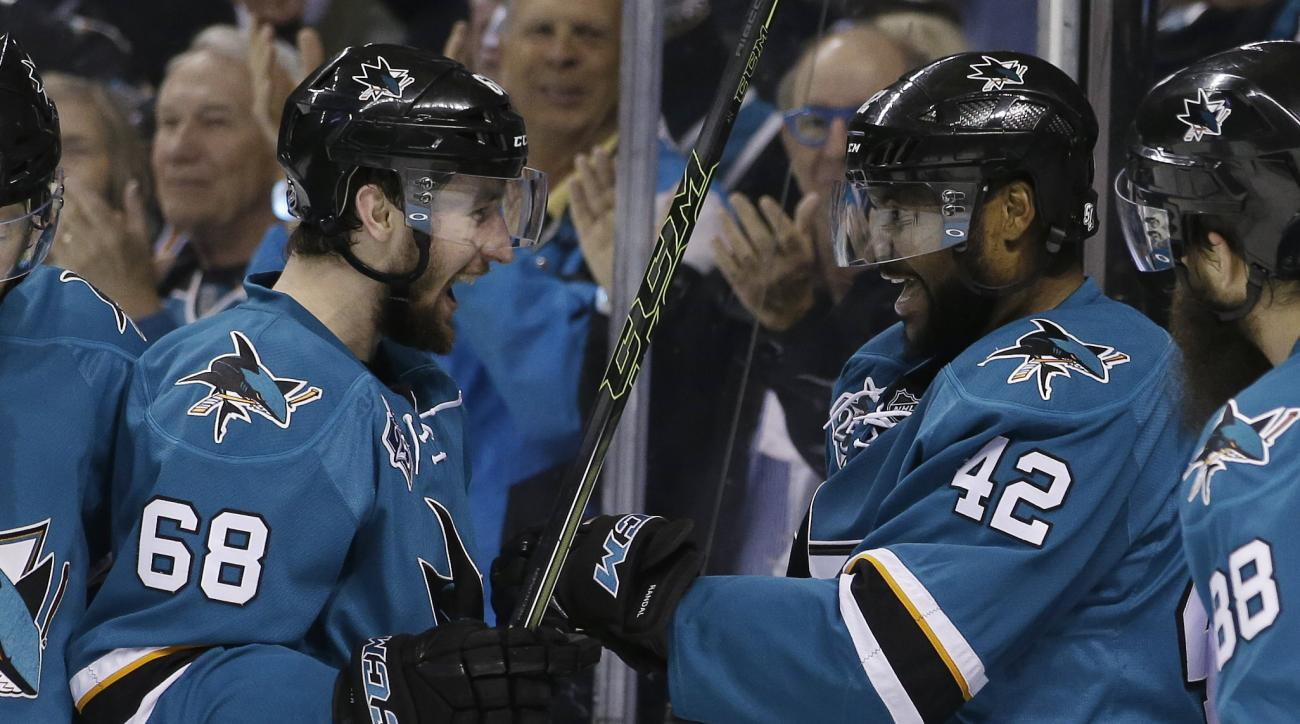 San Jose Sharks' Joel Ward (42) celebrates his goal with teammate Melker Karlsson (68) during the second period in Game 6 of the NHL hockey Stanley Cup Western Conference finals against the St. Louis Blues Wednesday, May 25, 2016, in San Jose, Calif. (AP