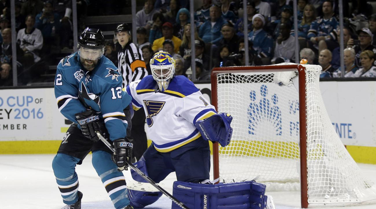 San Jose Sharks' Patrick Marleau (12) reaches for the puck next to St. Louis Blues goalie Brian Elliott (1) during the second period in Game 6 of the NHL hockey Stanley Cup Western Conference finals Wednesday, May 25, 2016, in San Jose, Calif. (AP Photo/M