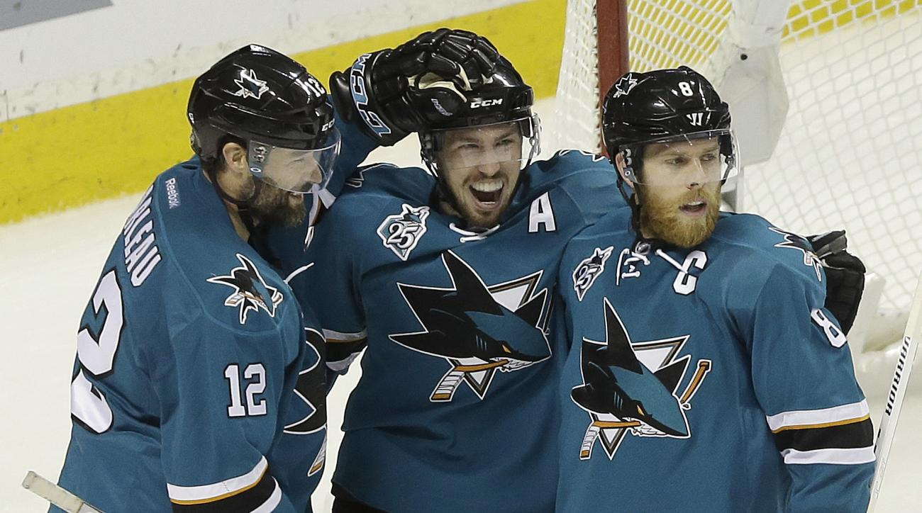 San Jose Sharks center Logan Couture, center, celebrates after scoring a goal with Patrick Marleau (12) and Joe Pavelski (8) during the third period in Game 6 of the NHL hockey Stanley Cup Western Conference finals against the St. Louis Blues in San Jose,
