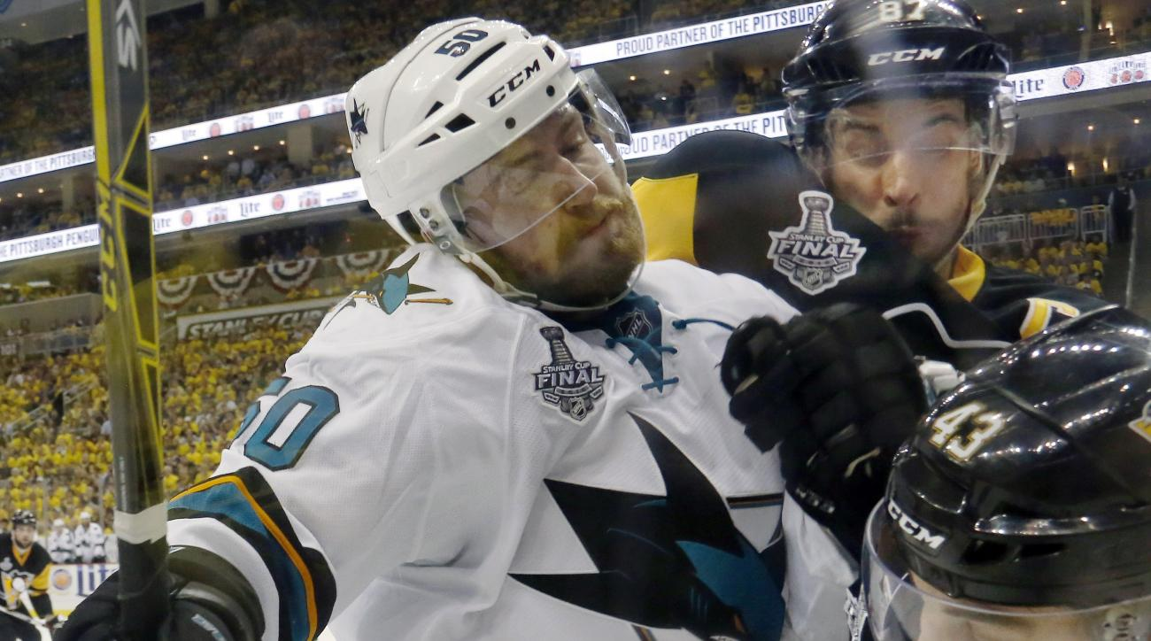 San Jose Sharks' Chris Tierney, left, collides with Pittsburgh Penguins' Sidney Crosby, rear, and Conor Sheary, right, during the third period in Game 2 of the NHL hockey Stanley Cup Finals on Wednesday, June 1, 2016, in Pittsburgh. (AP Photo/Keith Srakoc