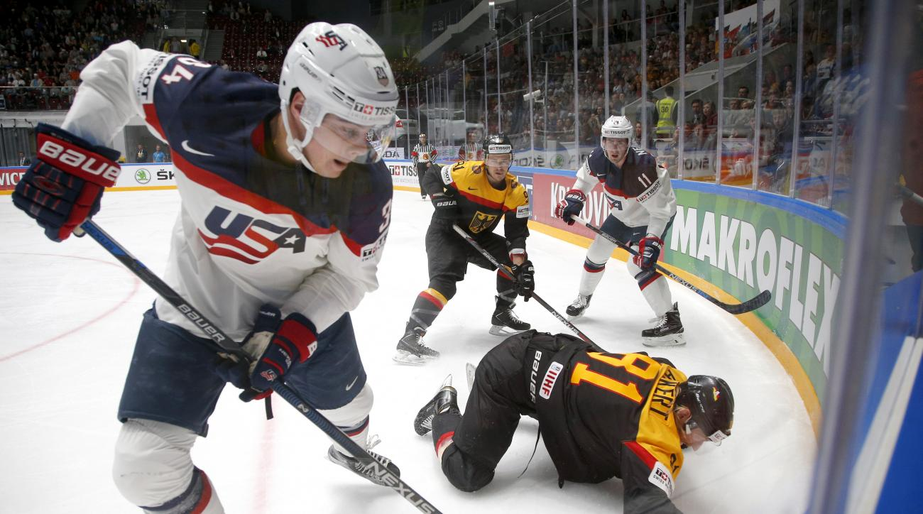 FILE - In this May 15, 2016 file photo, United States' Auston Matthews, left, fights for the puck with Germanys Torsten Ankert during a Hockey World Championships Group B match in St.Petersburg, Russia. Matthews spent the past year playing in Switzerland,