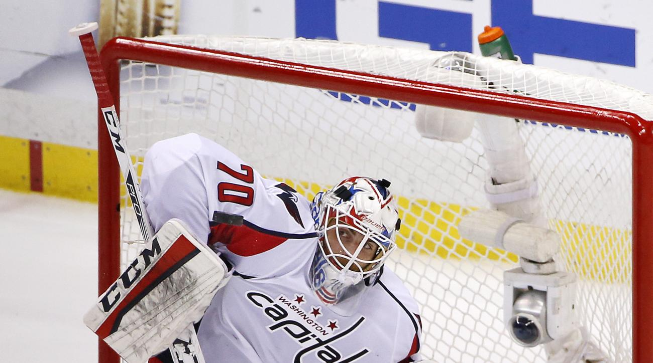 FILE - In this May 10, 2016 file photo, Washington Capitals goalie Braden Holtby blocks a shot during the third period of Game 6 in an NHL hockey Stanley Cup Eastern Conference semifinals against the Pittsburgh Penguins in Pittsburgh. Vezina Trophy finali