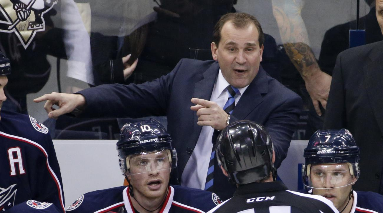 FILE - In this Dec. 13, 2014, file photo, Columbus Blue Jackets coach Todd Richards talks with an official during an NHL hockey game against the Pittsburgh Penguins in Columbus, Ohio. Richards has had plenty of time to plot his next adventure after the Bl