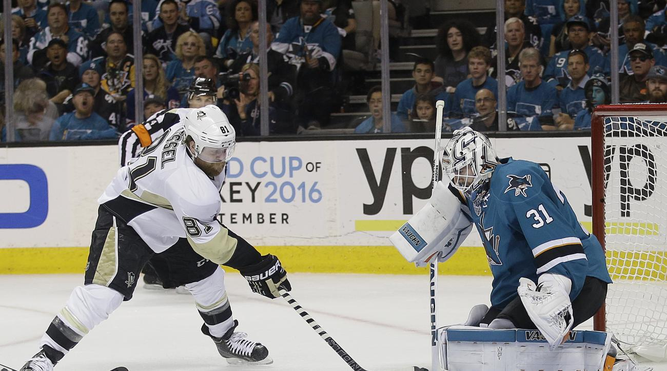 Pittsburgh Penguins right wing Phil Kessel (81) shoots against San Jose Sharks goalie Martin Jones (31) during the first period of Game 6 of the NHL hockey Stanley Cup Finals in San Jose, Calif., Sunday, June 12, 2016. (AP Photo/Marcio Jose Sanchez)