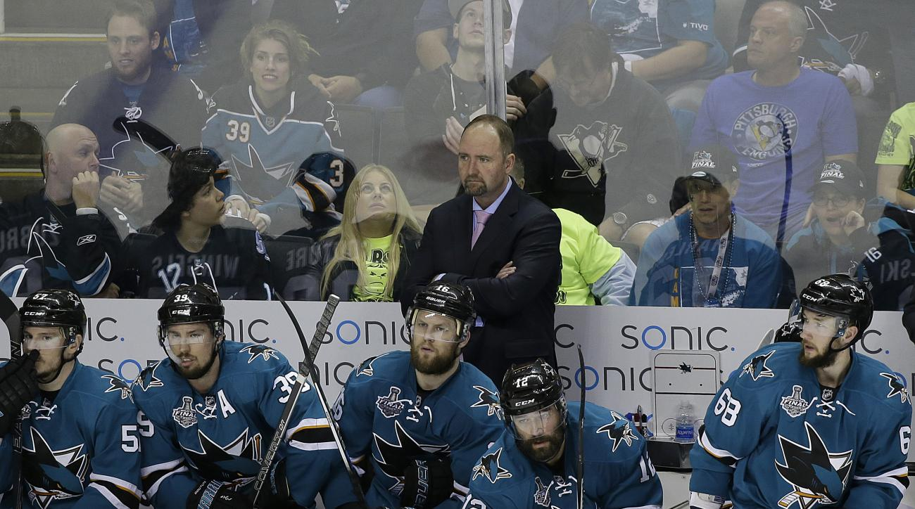 San Jose Sharks head coach Peter DeBoer, center, watches during the third period of Game 6 of the NHL hockey Stanley Cup Finals between the Sharks and the Pittsburgh Penguins in San Jose, Calif., Sunday, June 12, 2016. (AP Photo/Eric Risberg)