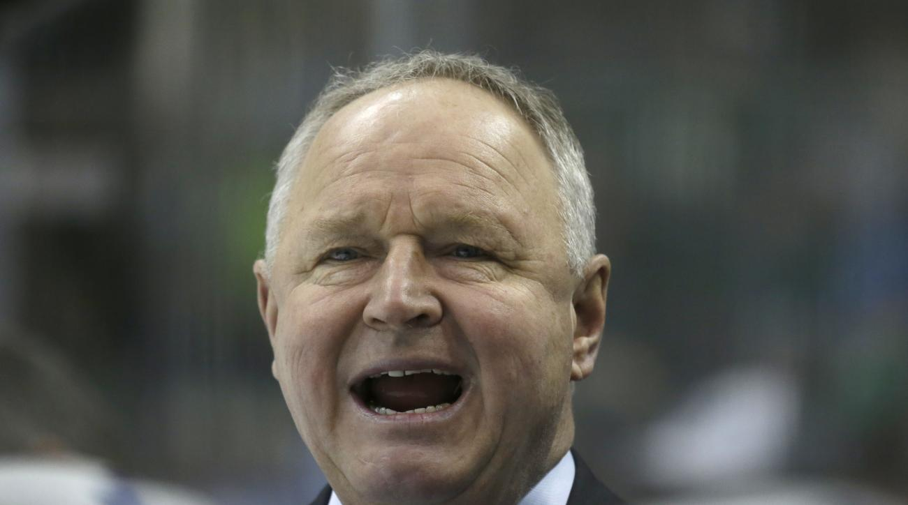 Toronto Maple Leafs head coach Randy Carlyle yells from the bench during the first period of an NHL hockey game against the Dallas Stars Tuesday, Dec. 23, 2014, in Dallas. (AP Photo/LM Otero)