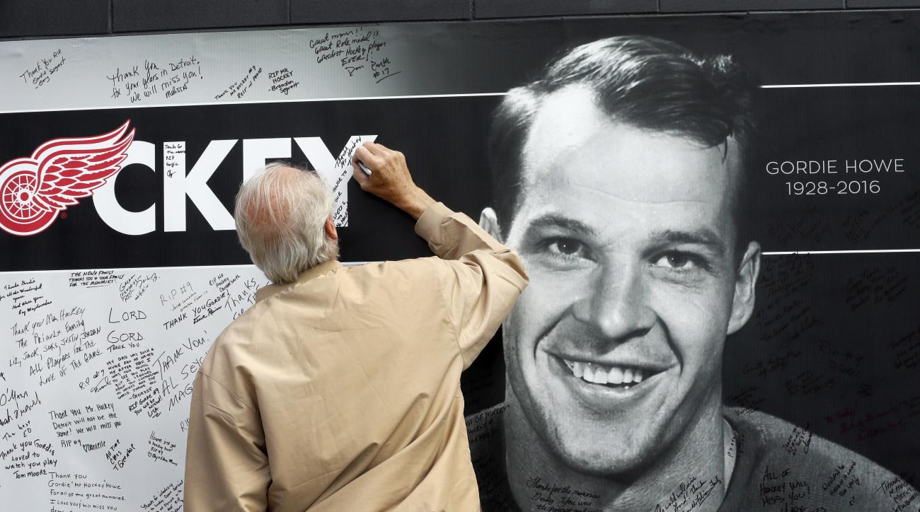 A fan leaves a tribute to Gordie Howe, the man known as Mr. Hockey, outside Joe Louis Arena, the home of the Detroit Red Wings, his team for much of his NHL Hall of Fame career, Tuesday, June 14, 2016 in Detroit. (AP Photo/Carlos Osorio)