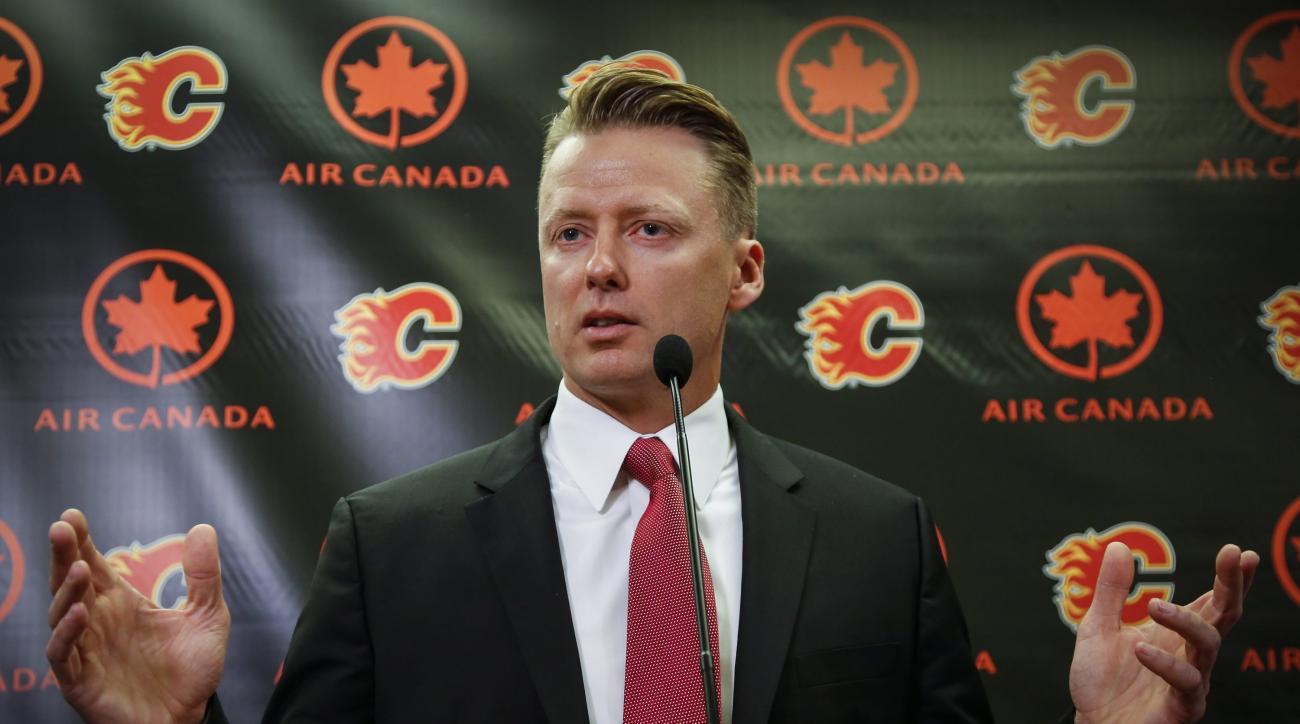 Calgary Flames  new head coach Glen Gulutzan speaks during an NHL hockey news conference in Calgary, Alberta, Friday, June 17, 2016. (Jeff McIntosh/The Canadian Press via AP) MANDATORY CREDIT