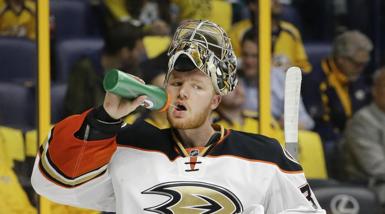 Anaheim Ducks goalie Frederik Andersen, of Denmark, takes a drink in the second period of Game 6 against the Nashville Predators in an NHL hockey first-round Stanley Cup playoff series Monday, April 25, 2016, in Nashville, Tenn. The Predators won 3-1 to e