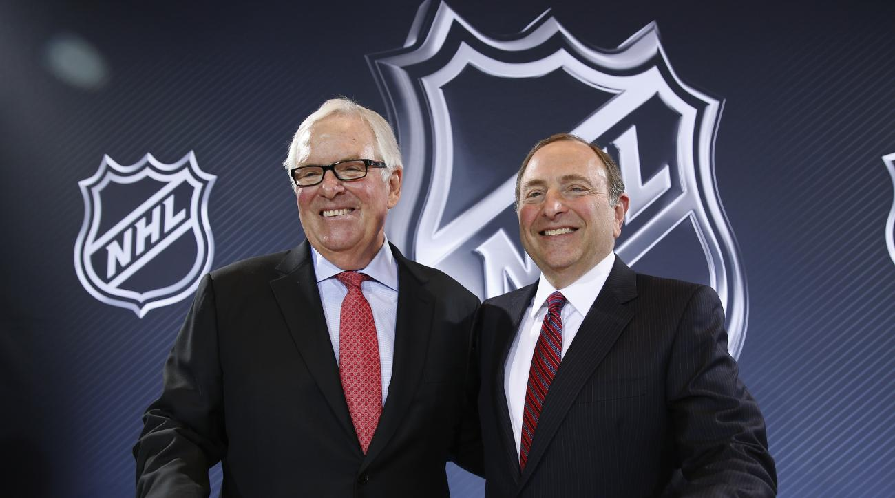 NHL Commissioner Gary Bettman, right, and Bill Foley pose for photographers during a news conference Wednesday, June 22, 2016, in Las Vegas. Bettman announced an expansion franchise to Las Vegas after the league's board of governors met in Las Vegas. Fole