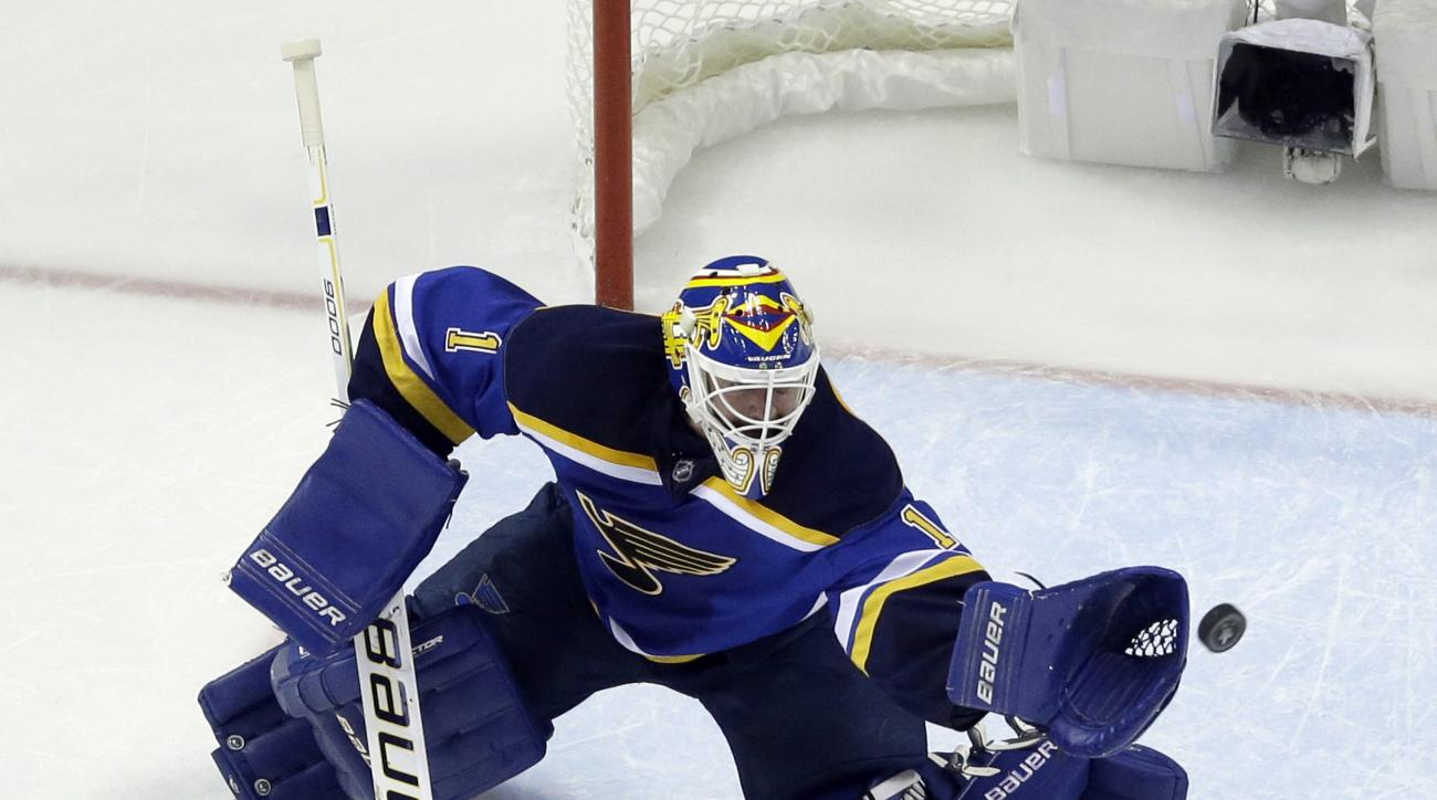 St. Louis Blues goalie Brian Elliott (1) makes the save during the second period in Game 2 of the NHL hockey Stanley Cup Western Conference finals against the San Jose Sharks, Tuesday, May 17, 2016, in St. Louis. (AP Photo/Jeff Roberson)