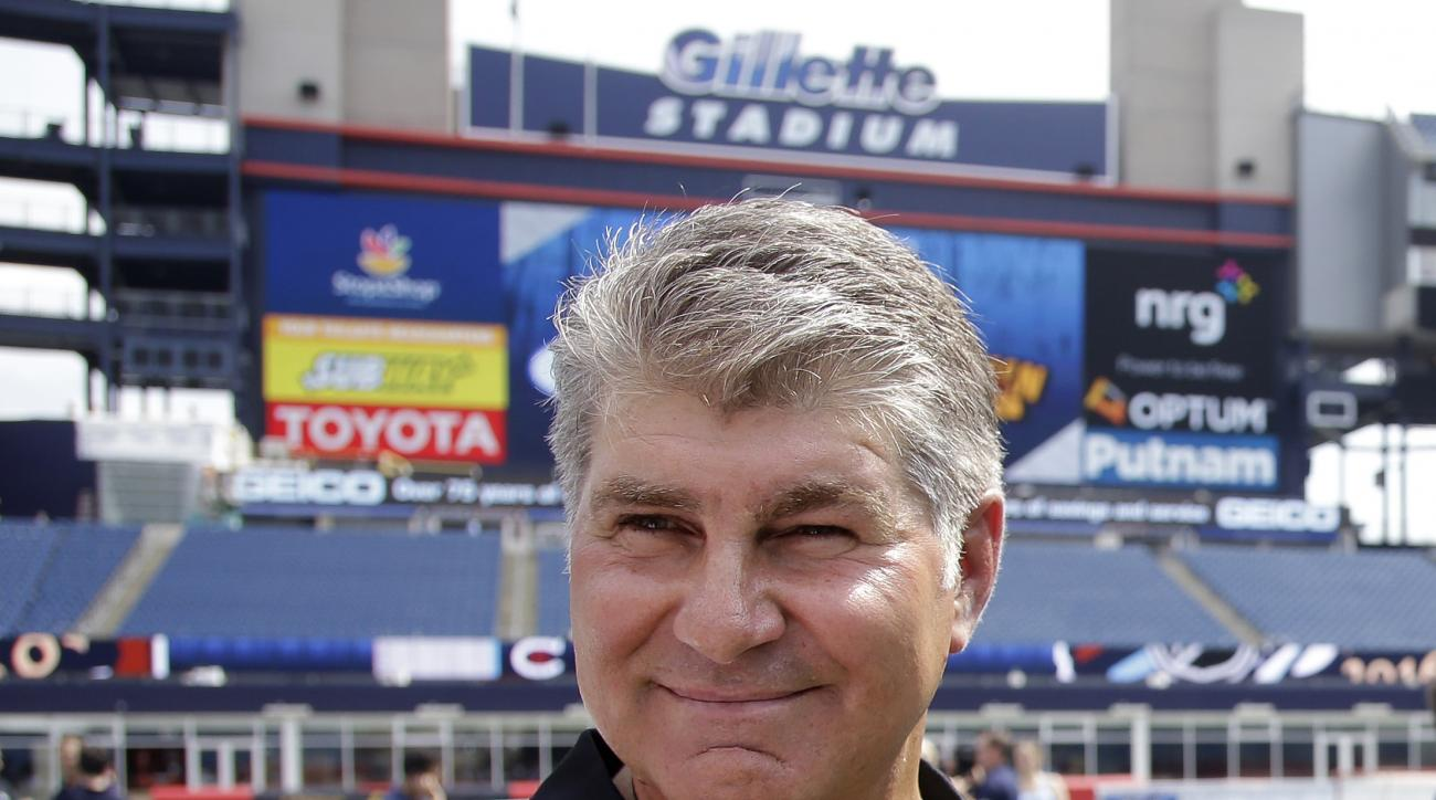 FILE - In this July 29, 2015, file photo, former Boston Bruins star Ray Bourque walks on the field during an event at Gillette Stadium  in Foxborough, Mass. Bourque has been arrested on a drunken driving charge. Andover, Mass., police Lt. Cecilia Blais te